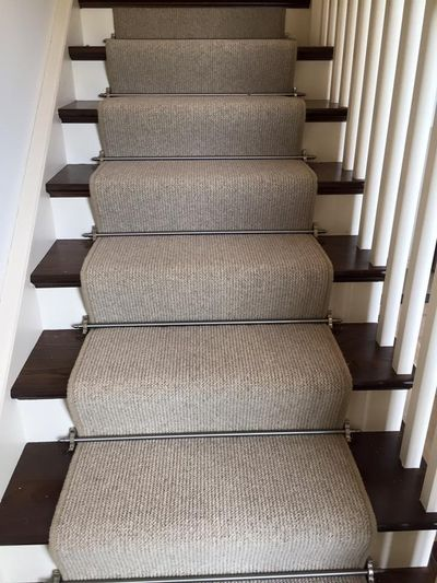 Neutral runner carpet with stair rods. Dan Sheehan Floor Coverings, Cork