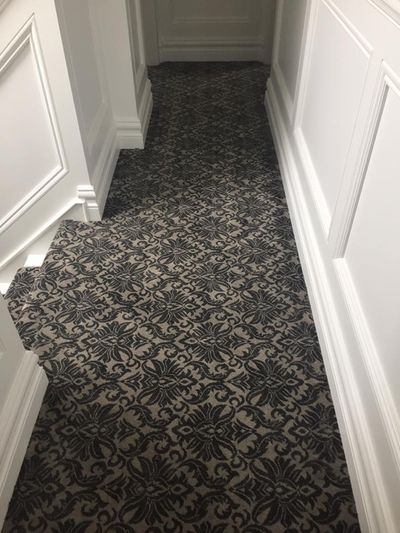 Dark pattern carpet fitted on iars and landing fitted by Cork flooring company Dan Sheehan Floor Coverings