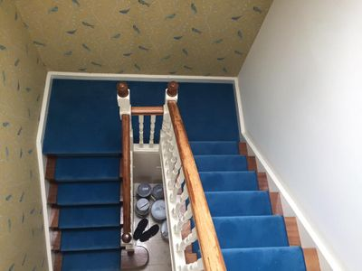 Stair carpet in blue bound carpet fitted by Cork flooring company Dan Sheehan Floor Coverings