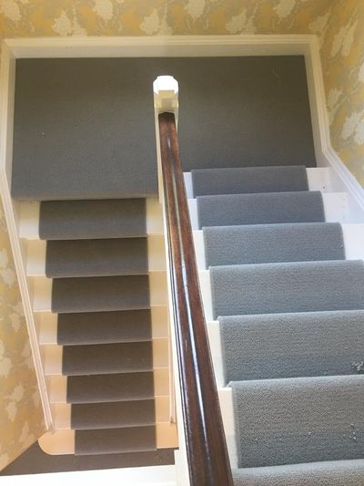 Grey carpet stair runner idea fitted by Cork flooring company Dan Sheehan Floor Coverings
