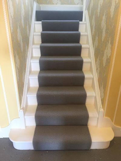 Grey Stair runner carpet idea fitted by Cork flooring company Dan Sheehan Floor Coverings