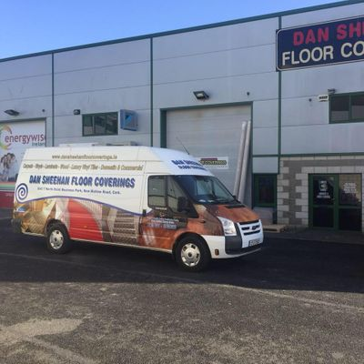 Exterior shot of flooring van and flooring shop in Dan Sheehan Floor Coverings